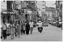 Malay people walking on street. George Town, Penang, Malaysia ( black and white)