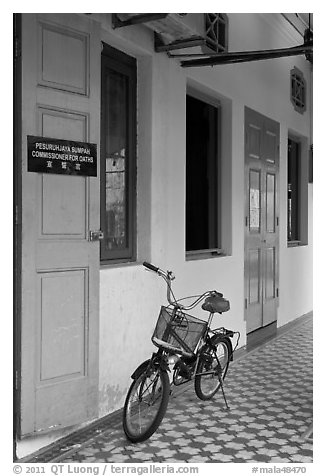 Bicycle in front of office. George Town, Penang, Malaysia (black and white)
