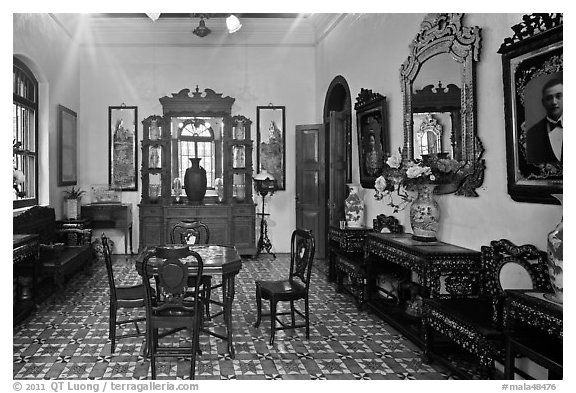 Room with furniture inside Pinang Peranakan Mansion. George Town, Penang, Malaysia (black and white)