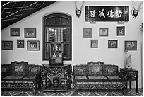 Antique furniture and images, Pinang Peranakan Mansion. George Town, Penang, Malaysia ( black and white)