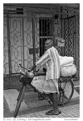 Malay with loaded bicycle. George Town, Penang, Malaysia (black and white)
