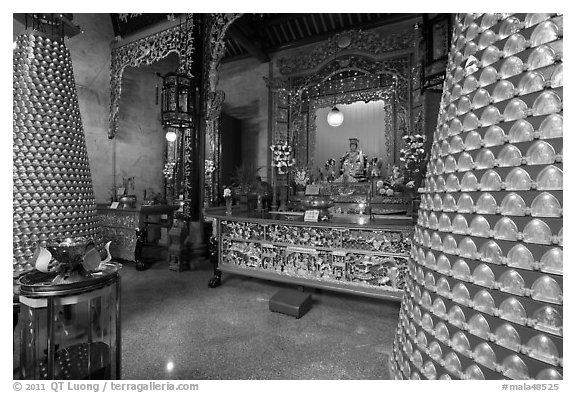 Wishing wheels and altar, Hainan Temple. George Town, Penang, Malaysia (black and white)
