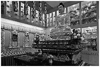 Buddha image inside Yellow Hat Buddhist temple. George Town, Penang, Malaysia ( black and white)