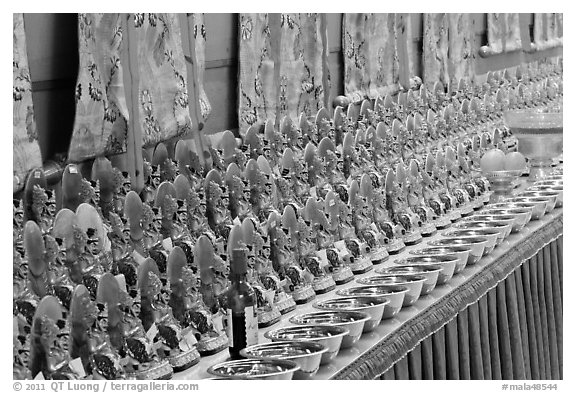 Rows of Jambhala figures, Gelugpa Buddhist Association temple. George Town, Penang, Malaysia (black and white)