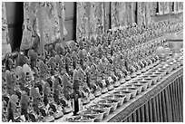 Rows of Jambhala figures, Gelugpa Buddhist Association temple. George Town, Penang, Malaysia ( black and white)