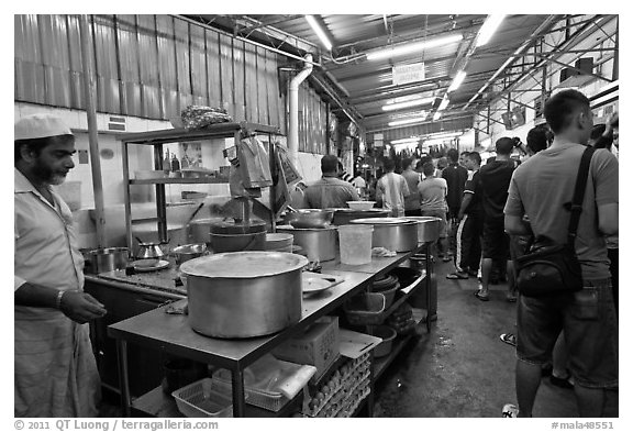 People waiting in line at popular eatery. George Town, Penang, Malaysia (black and white)
