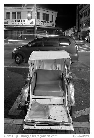 Rickshaw and auto at night. George Town, Penang, Malaysia (black and white)