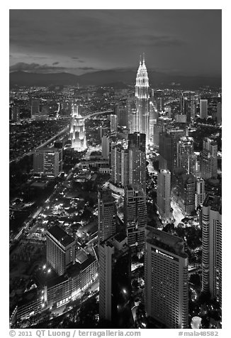 Skyscrappers dominated by Petronas Towers at night. Kuala Lumpur, Malaysia (black and white)
