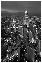 Skyscrappers dominated by Petronas Towers at night. Kuala Lumpur, Malaysia ( black and white)