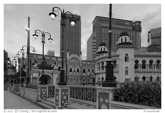 Street lamps and historic buildings at dawn, Merdeka Square. Kuala Lumpur, Malaysia (black and white)