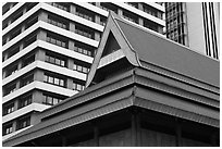 Roof of traditional tek house and modern buildings. Kuala Lumpur, Malaysia ( black and white)