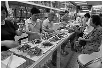 Store selling traditional Chinese medicine herbs. Kuala Lumpur, Malaysia ( black and white)