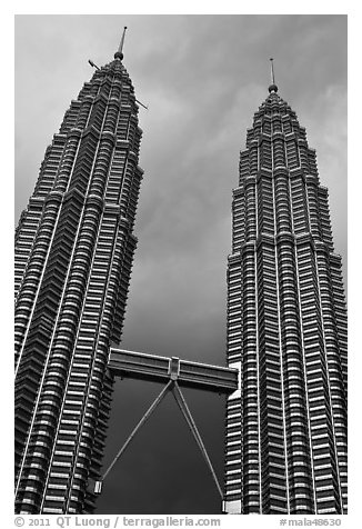 Petronas Towers (tallest twin towers in the world) and stormy sky. Kuala Lumpur, Malaysia (black and white)
