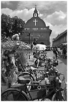 Malacca Town Square with trishaws and church. Malacca City, Malaysia (black and white)