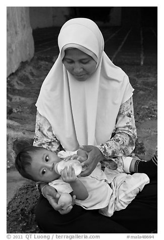Mother and infant, St Paul Hill. Malacca City, Malaysia (black and white)