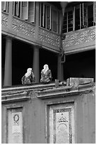 Women sitting, Stadthuys. Malacca City, Malaysia (black and white)