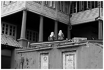 Stadthuys detail with two women. Malacca City, Malaysia (black and white)