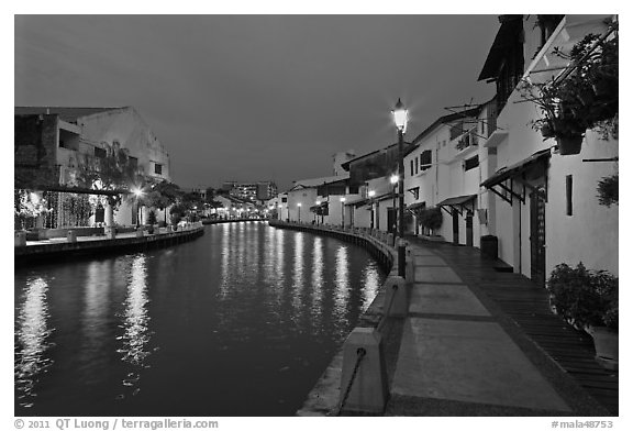 Houses and walkway at dusk, Melaka River. Malacca City, Malaysia (black and white)