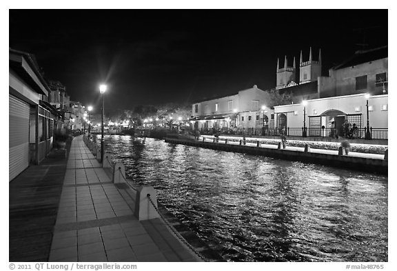 Melaka River at night with St Peters Church towers. Malacca City, Malaysia (black and white)