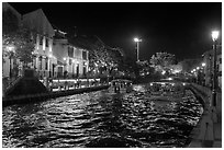 Tour boats on Melaka River at night. Malacca City, Malaysia ( black and white)