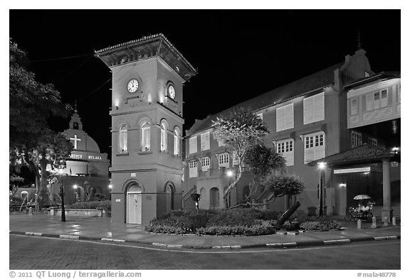 Town Square with Stadthuys, clock tower, and church at night. Malacca City, Malaysia (black and white)