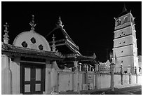 Gate, Mosque, and minaret, Masjid Kampung Hulu at night. Malacca City, Malaysia (black and white)