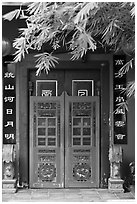Weathered door with chinese signs and lanterns. Malacca City, Malaysia ( black and white)