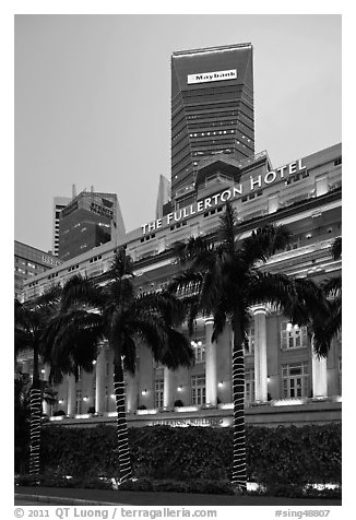 Fullerton Hotel and Maybank tower at dusk. Singapore (black and white)