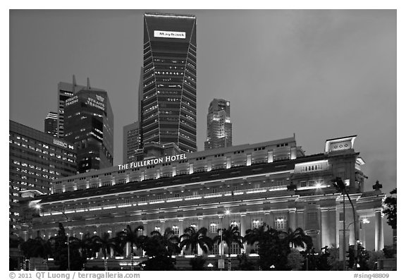 Fullerton Hotel and high rises at dusk. Singapore (black and white)