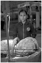 Young street food vendor by night. Guadalajara, Jalisco, Mexico (black and white)