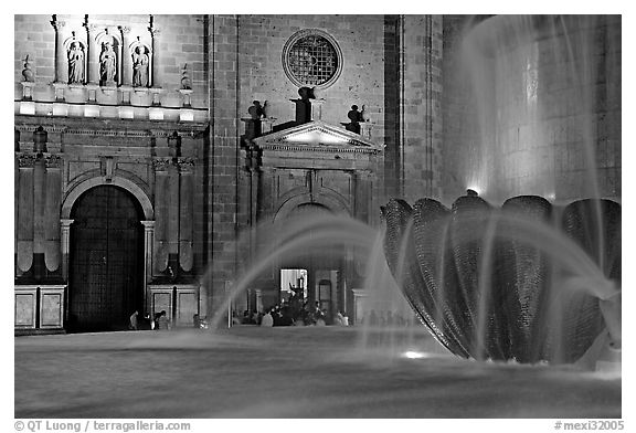 Fountain and cathedral wall by night. Guadalajara, Jalisco, Mexico (black and white)