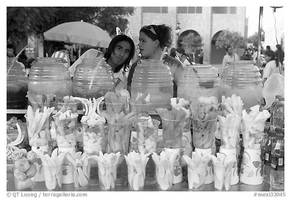 Cups of fresh fruits offered for sale on the street. Guadalajara, Jalisco, Mexico (black and white)