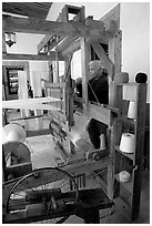 Traditional weaver and machine seen from the side, Tlaquepaque. Jalisco, Mexico (black and white)