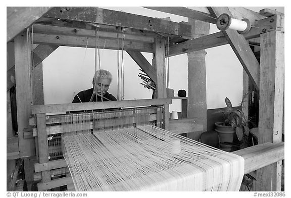 Weaver operating a traditional machine, Tlaquepaque. Jalisco, Mexico (black and white)