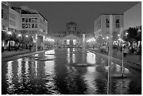Plaza Tapatia at night with Hospicio Cabanas reflected in basin. Guadalajara, Jalisco, Mexico (black and white)