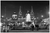 Plaza de la Liberacion with fountain and Cathedral by night. Guadalajara, Jalisco, Mexico (black and white)