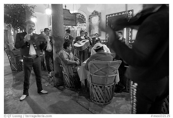 Mariachi musicians performing a serenade at the Parian, Tlaquepaque. Jalisco, Mexico (black and white)