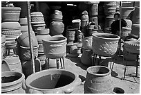 Boy standing next to clay pots, Tonala. Jalisco, Mexico (black and white)