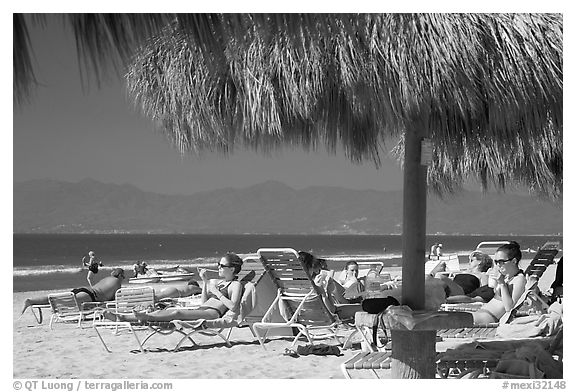 People lying on beach chairs, Nuevo Vallarta, Nayarit. Jalisco, Mexico (black and white)
