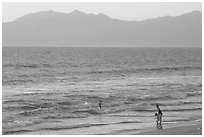 Woman holding children on the beach at sunset, Nuevo Vallarta, Nayarit. Jalisco, Mexico ( black and white)
