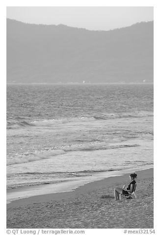 Woman sitting on the beach looking at the sunset, Nuevo Vallarta, Nayarit. Jalisco, Mexico (black and white)