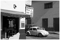 Restaurant at a street corner and Mexico made Wolskwagen bug, Puerto Vallarta, Jalisco. Jalisco, Mexico ( black and white)