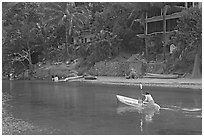 Woman using a canoe in a village,  Boca de Tomatlan, Jalisco. Jalisco, Mexico ( black and white)