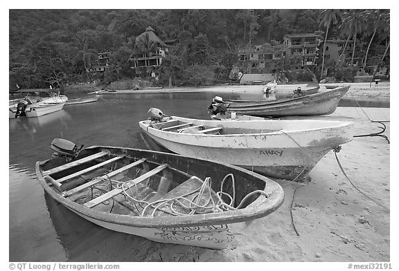 Small boats beached in a lagoon in fishing village, Boca de Tomatlan, Jalisco. Jalisco, Mexico (black and white)