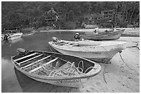 Small boats beached in a lagoon in fishing village, Boca de Tomatlan, Jalisco. Jalisco, Mexico ( black and white)