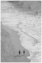 Couple walking on the beach seen from above, Puerto Vallarta, Jalisco. Jalisco, Mexico ( black and white)