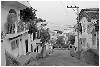 Steep street in morning foggy weather, Puerto Vallarta, Jalisco. Jalisco, Mexico ( black and white)