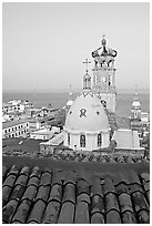 Red tile roof, Templo de Guadalupe Cathedral, and ocean early morning, Puerto Vallarta, Jalisco. Jalisco, Mexico ( black and white)