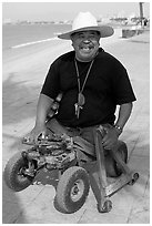Man without legs  smiling on the Malecon, Puerto Vallarta, Jalisco. Jalisco, Mexico ( black and white)