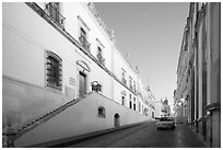 Car in street at dawn with Zacatecas Museum. Zacatecas, Mexico ( black and white)